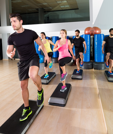 Cardio step dance people group at fitness gym training workout photo