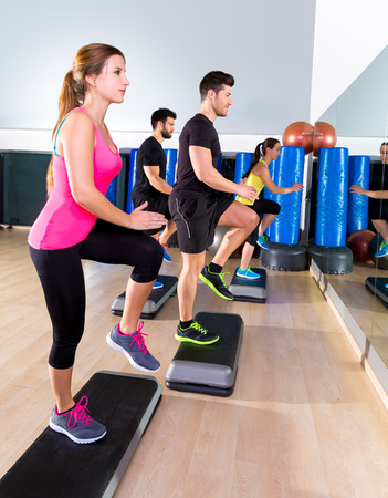 dance steps: Cardio step dance people group at fitness gym training workout