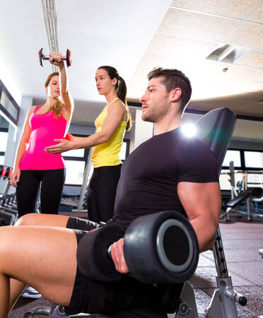 body work: Dumbbell man at gym workout fitness weightlifting and dumbbell women personal trainer Stock Photo