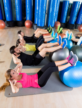 Fitball crunch training group core fitness at gym abdominal workout Stock Photo