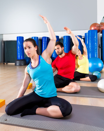 pilates man: Pilates exercise the mermaid stretching obliques people group at fitness gym