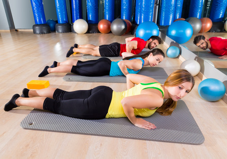 Pilates Yoga training exercise in fitness gym people group photo