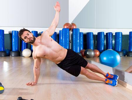 Fitness side push ups man pushup at gym workout execises photo