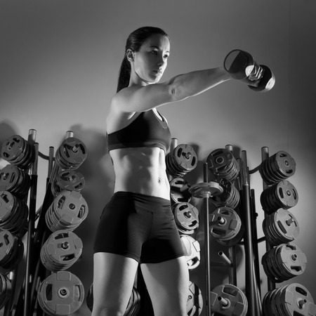 weight room: Dumbbell woman workout fitness club at weightlifting gym