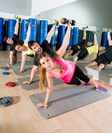 functional: Dumbbell push up group functional training circuit at fitness gym