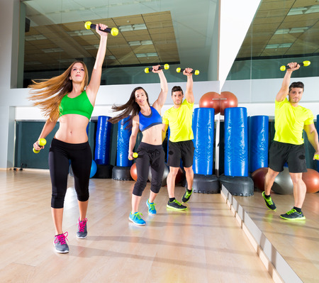 zumba dance cardio people group training at fitness gym workout exercise photo
