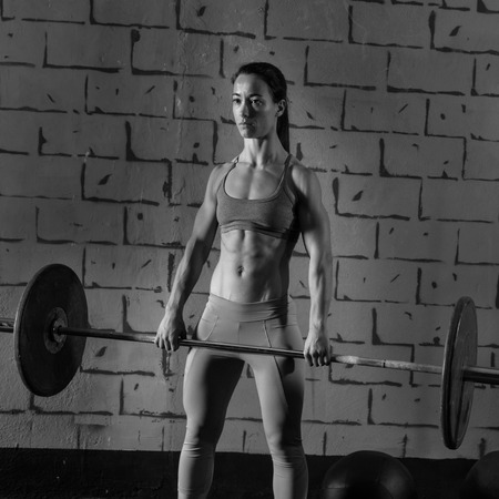 weight weightlifting: Barbell weight lifting woman workout exercise gym weightlifting Stock Photo