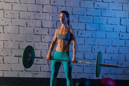 cross bar: Barbell weight lifting woman workout exercise gym weightlifting Stock Photo