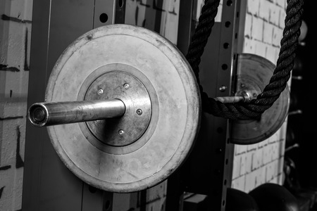 cross bar: Barbells in a gym bar bells and rope at cross fit