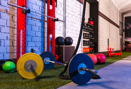 recreation room: Barbells in a gym bar bells and rope at cross fit