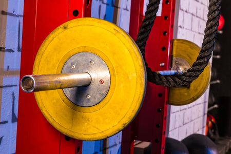 Barbells in a gym bar bells and rope at cross fit photo