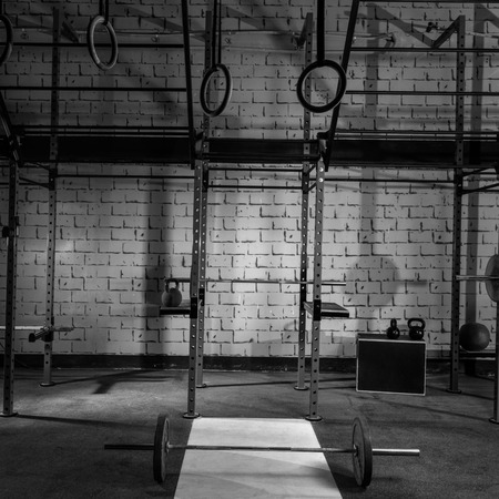 gymnasium: Gym nobody with barbells kettlebells bars and weightlifting gear