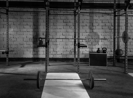 Gym nobody with barbells kettlebells bars and weightlifting gear photo