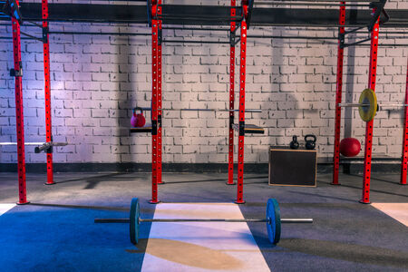 cross bar: Gym nobody with barbells kettlebells bars and weightlifting gear