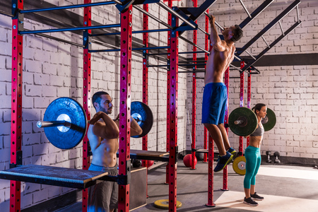 sports bar: Barbell weight lifting group weightlifting workout exercise gym