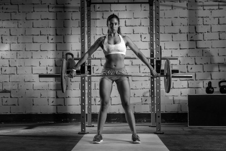 sexy female body: Barbell weight lifting woman weightlifting workout exercise gym Stock Photo