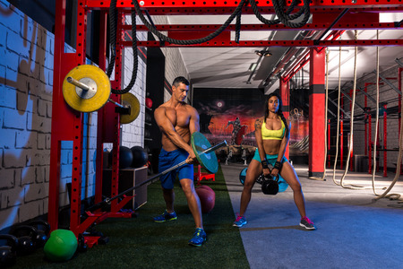 physical training: woman man gym group weightlifting workout exercise Stock Photo