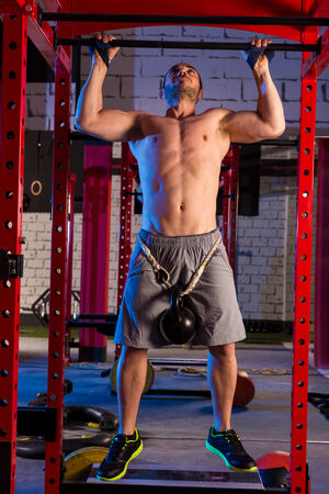 cross bar: Toes to bar with with a kettle bell tied to a weight belt man bars workout