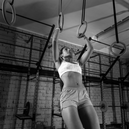 dip ring girl woman muscle ups rings workout at gym photo