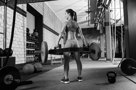 weight weightlifting: Hex Dead Lift Shrug Bar Deadlifts woman at gym workout weightlifting Stock Photo