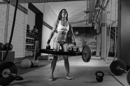 sexy indian girl: Hex Dead Lift Shrug Bar Deadlifts woman at gym workout weightlifting Stock Photo