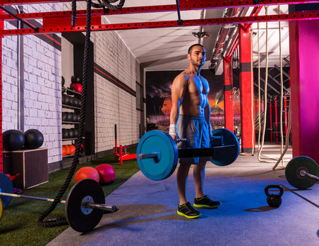 Hex Dead Lift Shrug Bar Deadlifts man at gym workout weightlifting Stock Photo