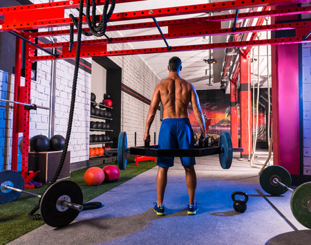 hex: Hex Dead Lift Shrug Bar Deadlifts man at gym workout weightlifting Stock Photo