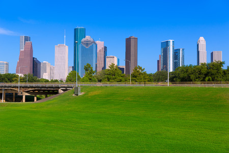 houston: Houston skyline blue sky and Memorial park turf at Texas USA US Stock Photo