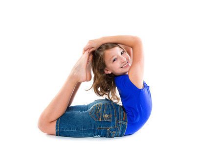 contortionist: Flexible contortionist kid girl playing happy on white background Stock Photo