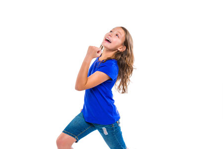 blue jeans kids: Excited winner expression kid girl gesture running with blue jeans on white background