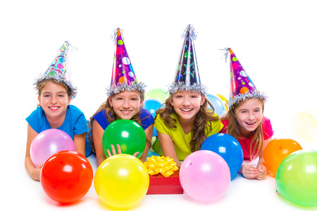 birthday party kids: Happy kid girls birthday party balloons and gift box on white background Stock Photo