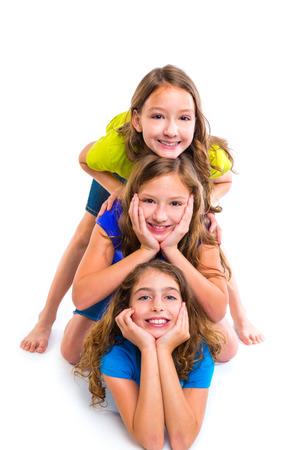 cufflink: Three kid girls friends happy stacked in a row portrait on white background