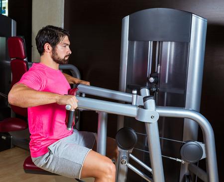 machine man: Seated back row machine man workout exercise at gym