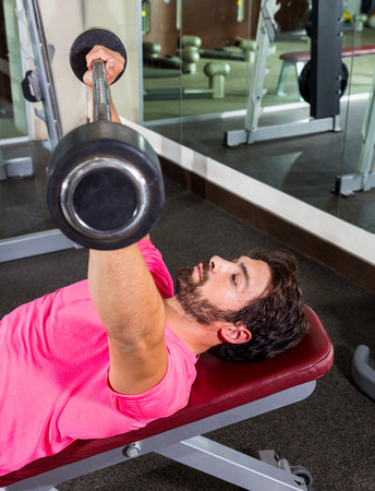 inclined: Barbell inclined bench Press flyes man exercise workout at gym Stock Photo