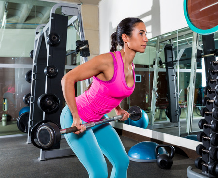 gripping bars: Barbell bent over row supine grip woman workout at gym exercise