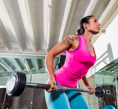 bent over: Barbell bent over row supine grip woman workout at gym exercise
