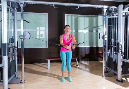 pulley: Standing cable crossover fly pulley flies woman workout at gym