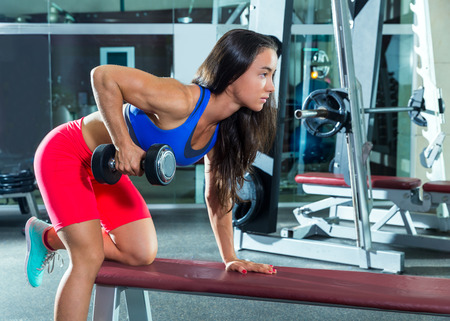 dumbbell triceps kickback girl workout exercise at gym Stock Photo