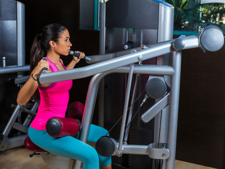 dorsal: Lat Lateral dorsal pulldown machine upper back exercises woman at gym workout