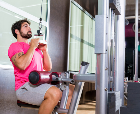 machine man: Cable Lat pulldown machine man workout at gym exercise Stock Photo