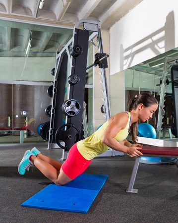 knees up: knees bench triceps push up push-up woman at gym workout exercise
