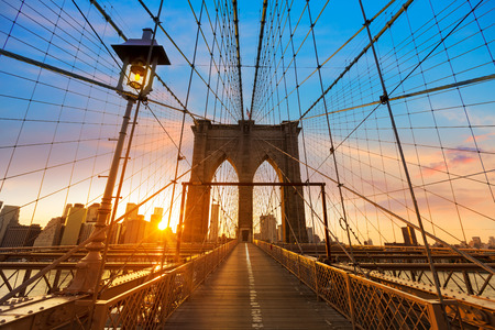 brooklyn: Brooklyn Bridge sunset New York Manhattan skyline NY NYC USA Stock Photo