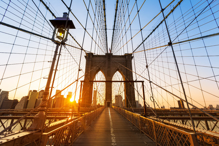 Brooklyn Bridge sunset New York Manhattan skyline NY NYC USA Stock Photo