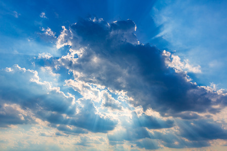 skyscape: Dramatic cloudy sky clouds with real sun beams  Stock Photo