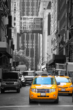 avenues: Fift avenue neigbourhood yellow cab taxi 5 th Av New York Manhattan USA Stock Photo