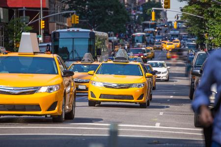 taxi famous building: Fift avenue yellow cab taxi 5 th Av New York Manhattan USA