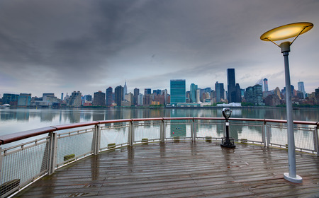 Manhattan New York cloudy dramatic skyline sunset from East River dusk USA photo
