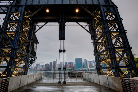 floodgates: Manhattan New York cloudy skyline from East River floodgates structure USA
