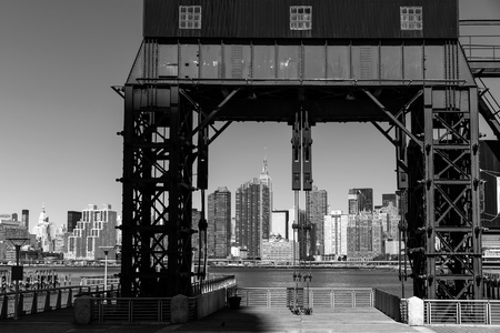 floodgates: Manhattan New York skyline BW from East River floodgates structure USA