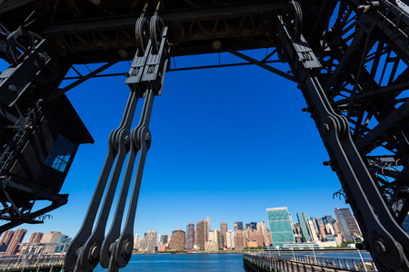 Manhattan New York skyline sunny from East River floodgates structure USA Stock Photo